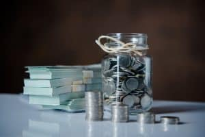 Cash and coins in a jar