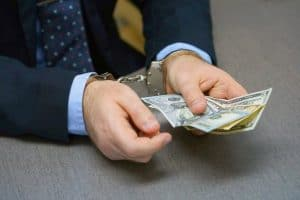 Guy in handcuff with money