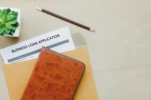 Business loan appcation form on wooden table